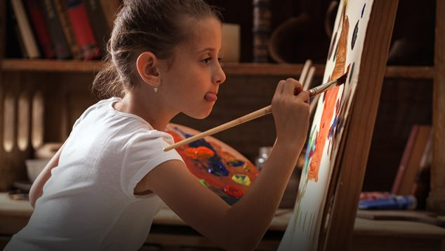 child painting inside