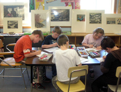 Students engaging with art in their classroom