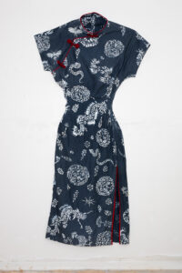Large navy dress with white stencil designs and red accents